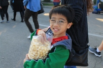 Matthew enjoying kettle corn while viewing the Rose Parade floats in Pasadena