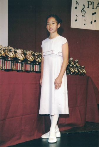 Piano recital circa early 2000's. Check out those white stockings and pointed toe!